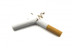 Broken cigarette isolated on white background. Stop smoking conc